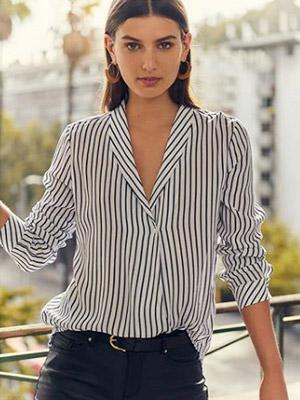 Blusas y poleras de distintos colores, estilos y marcas